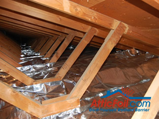 AtticFoil radiant barrier foil insulation installation over insulation between trusses