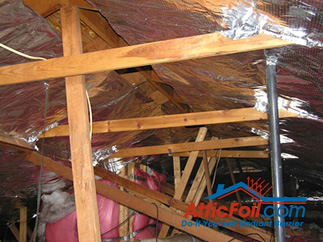 AtticFoil radiant barrier foil insulation installation photo open ridge method