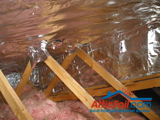 AtticFoil radiant barrier foil insulation installation photo truss attic