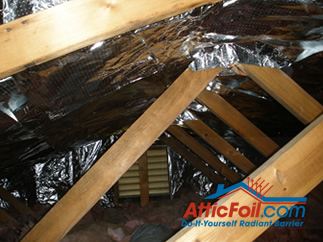 AtticFoil radiant barrier foil insulation installation photo gable end attic vent