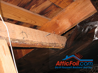 AtticFoil radiant barrier foil insulation installation photo foil around obstacles in attic