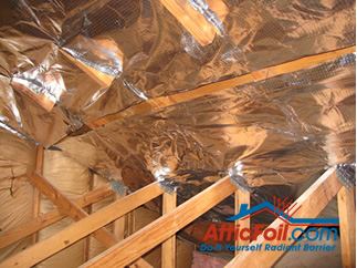 AtticFoil radiant barrier foil insulation installation photo slit for ventilation