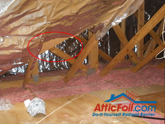 AtticFoil radiant barrier foil insulation installation photo staple up