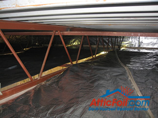AtticFoil radiant barrier foil insulation installation over purlins metal building
