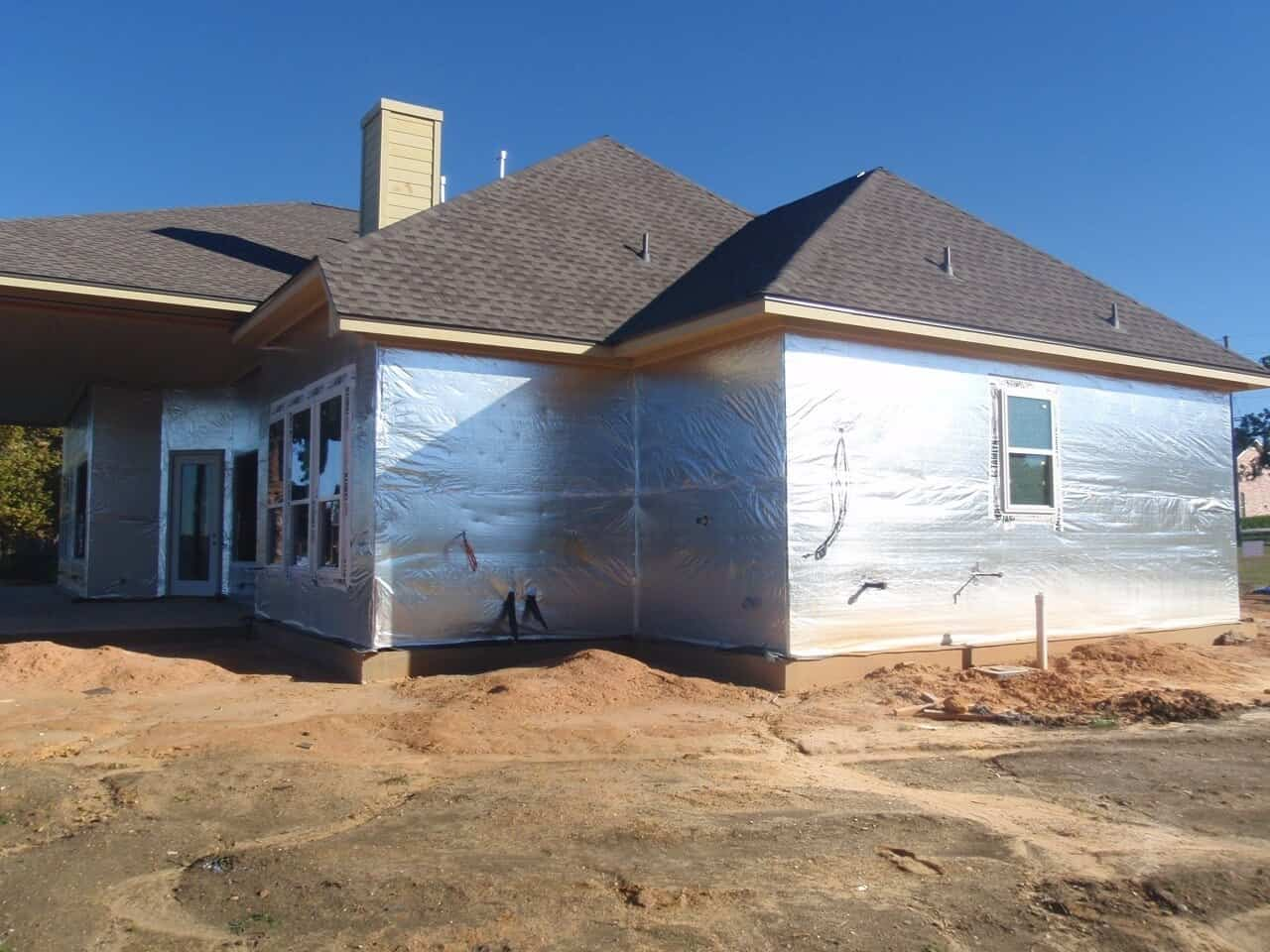 Gallery house wrap installs atticfoil radiant barrier for Sheathing house wrap